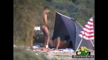 candid mature beach Man fondles his pretty girl